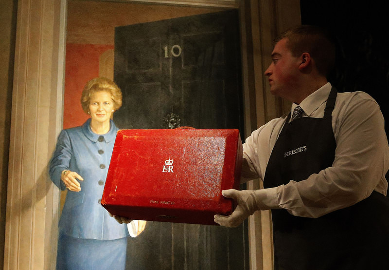 A Friday, Dec. 11, 2015 photo from files showing a Christie's employee holding the red leather Prime Ministerial Dispatch Box at the auction house Christie's in London. (AP Photo)
