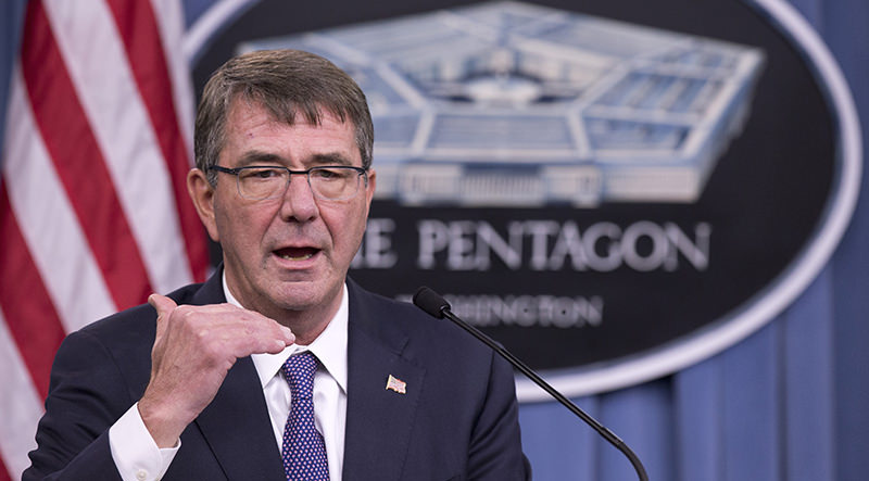 Defense Secretary Ash Carter speaks to reporters during a joint news conference with British Defense Secretary Michael Fallon, Friday, Dec. 11, 2015 (AP Photo)