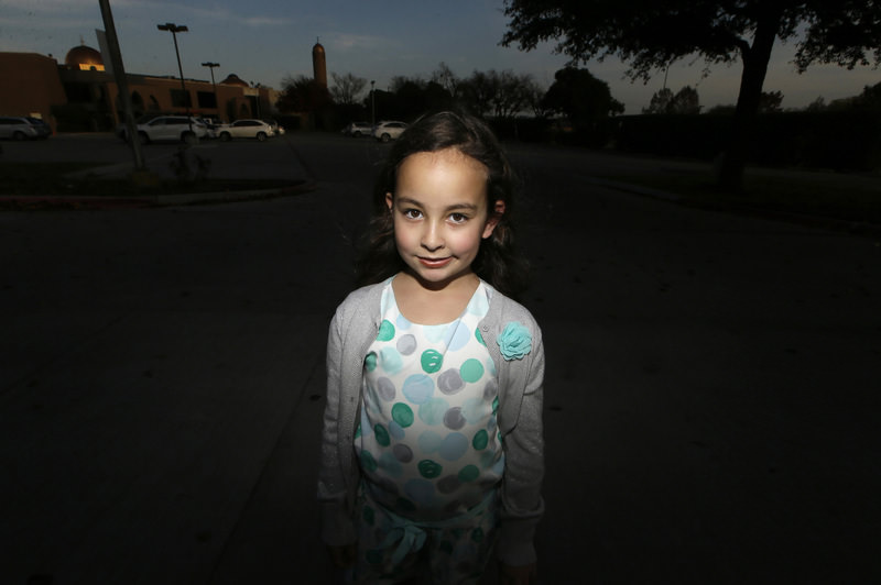 Sofia Yassini, 8, poses for a photo outsider a mosque in Richardson, Texas, Friday, Dec. 11, 2015. (AP Photo)