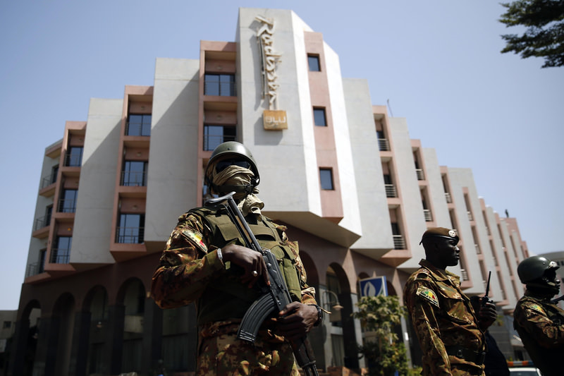 this Saturday, Nov. 21, 2015 file photo, soldiers stand guards in front of Radisson Blu hotel prior to the visits of Malian President Ibrahim Boubacar Keita in Bamako, Mali. (AP Photo)