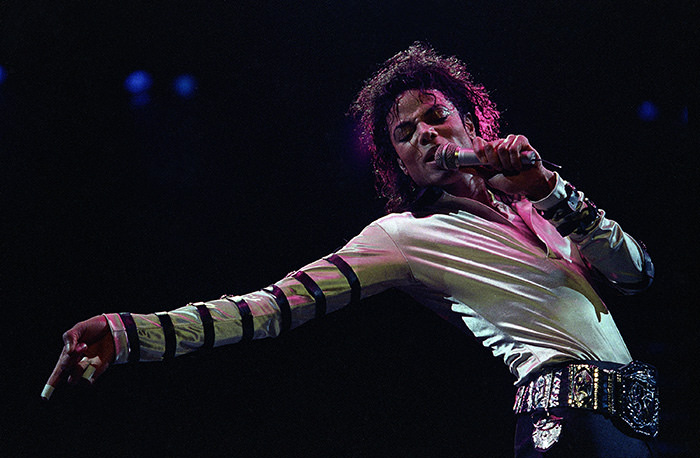 1988 file photo, Michael Jackson leans, points and sings, dances and struts during the opening performance of his 13-city U.S. tour (AP Photo)