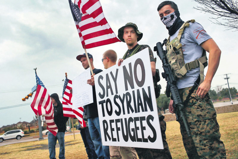 Armed protesters take part in a demonstration in front of a mosque on Dec. 12 in Richardson, Texas.