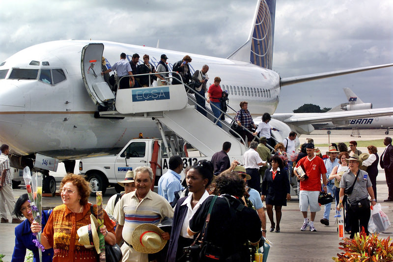 In this Nov. 1, 2001, file photo, the first passengers of the first flight of Continental Airlines from Florida, arrives at the Jose Marti Airport of Havana, Cuba. (AP Photo)