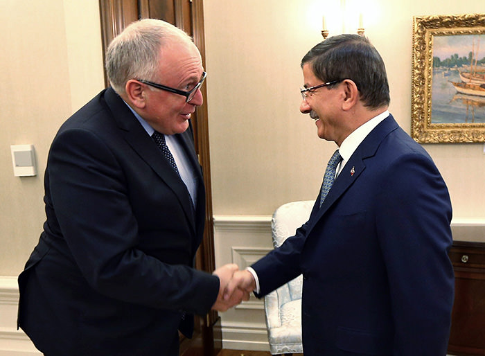 Turkeyu2019s Prime Minister Ahmet Davutoglu, right, greets European Commissionu2019s Frans Timmermans before a meeting in Ankara, Turkey, Wednesday, Nov. 11, 2015 (AP Photo)
