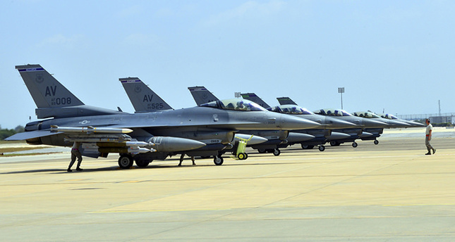 Six U.S. Air Force F-16 Fighting Falcons from Aviano Air Base, Italy, are seen at Incirlik Air Base, Turkey, after being deployed, in this U.S. Air Force handout picture taken August 9, 2015.(Reuters Photo)