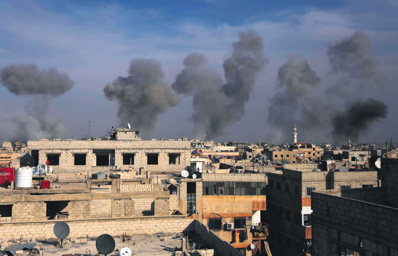 Smoke billows after airstrikes by regime forces on the town of Douma in the eastern Ghouta region, a moderate stronghold east of the capital Damascus, Syria.