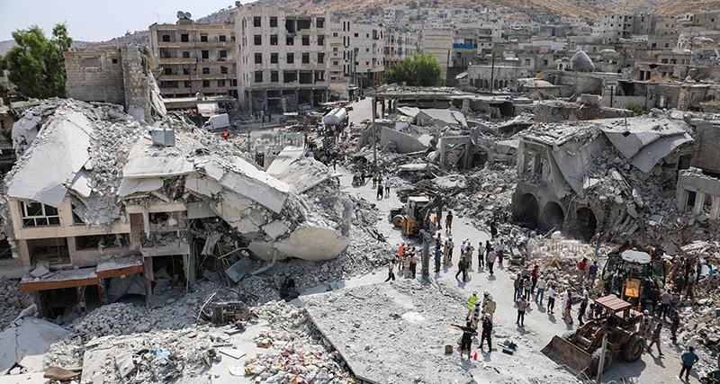 This photoshows the scene after a government warplane crashed in the center of the town of Ariha, in the northwestern province of Idlib, Syria, Monday, Aug. 3, 2015. (AP Photo)