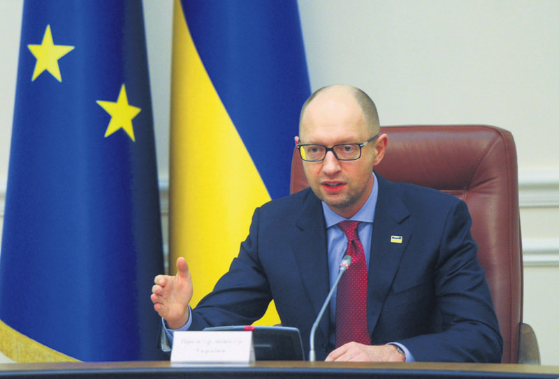 Ukrainian Prime Minister Arseniy Yatsenyuk at his cabinet meeting in Kiev on Friday. Ukraine declared a moratorium on paying back the $3 billion it borrowed from Russia in 2013, Yatsenyuk told his cabinet of ministers.