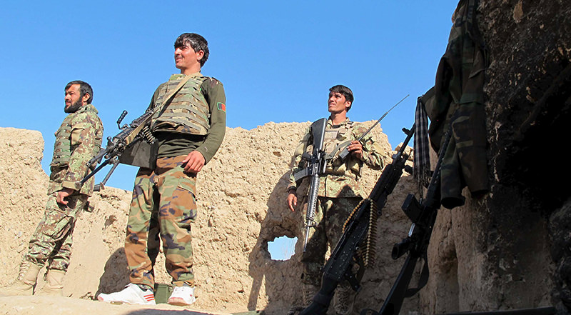 Afghan National Army (ANA) soldiers stand at an outpost in Helmand province, December 20, 2015. (Reuters Photo)