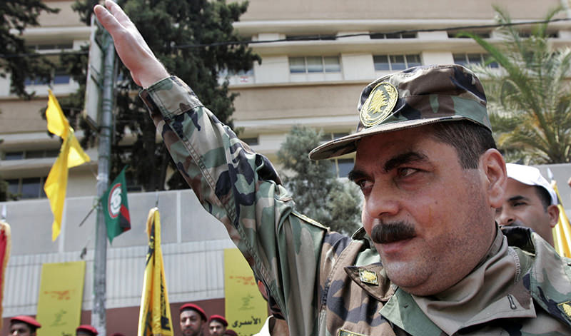 In this July 17, 2008, file photo, released prisoner Samir Kantar salutes people as he arrives to pay respect at the grave of slain top Hezbollah military commander Imad Mughniyeh, south of Beirut, Lebanon (AP Photo)