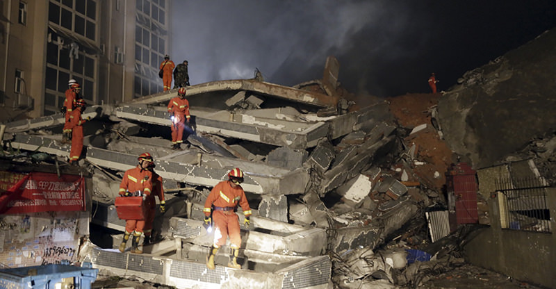 Rescuers search for survivors amongst collapsed buildings in the aftermath of a landslide in Shenzhen in south China's Guangdong province Sunday Dec. 20, 2015 (AP Photo