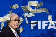This file photo taken on July 20, 2015 shows FIFA president Sepp Blatter looking on with fake dollars note flying around him thrown by a protester (AFP photo)