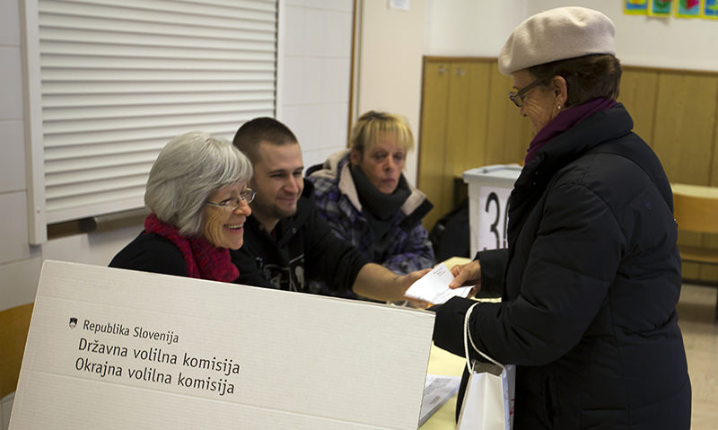 A voter is registered at a polling station in Ljubljana, Slovenia, Sunday, Dec. 20, 2015 (AP Photo)