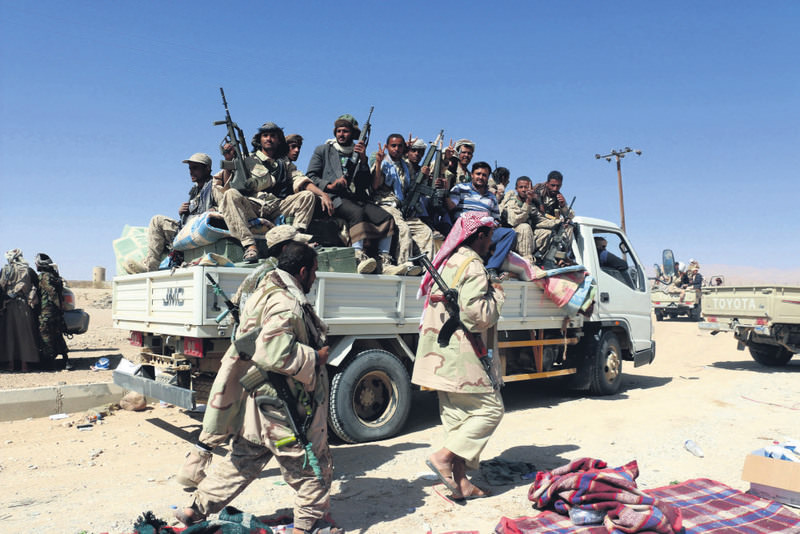 Armed tribesmen loyal to Yemen's Saudi-backed government hold a Houthi position in the northeast province of al-Jouf, Yemen.