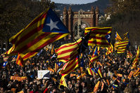 In this Nov. 22, 2015 file photo, pro Independence demonstrators wave esteladas or pro independence flags, during a demonstrations to show public support for the Parliament of Catalonia, in Barcelona (AP Photo)
