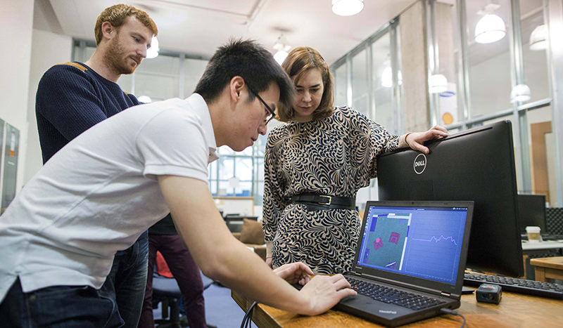 In this Nov. 19, 2015, photo, Massachusetts Institute of Technology researcher Chen-Yu Hsu works on a laptop as researcher Zach Kabelac, left, and professor Dina Katabi, right, watch in their lab at MIT (AP Photo)