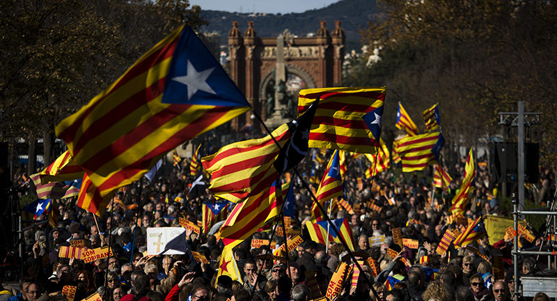 In this Nov. 22, 2015 file photo, pro Independence demonstrators wave ,esteladas, or pro independence flags, during a demonstrations to show public support for the Parliament of Catalonia, in Barcelona (AP Photo)