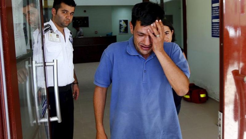 Abdullah Kurdi, Aylanu2019s father, cries as he leaves a morgue in Mugla, Turkey. The family had been fleeing the war-torn Syrian town of Kobani in a boat apparently headed for Greece. (Reuters Photo