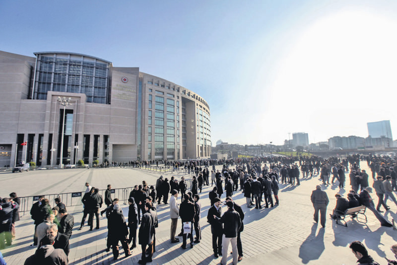 Supporters of Gu00fclenists gather outside the courthouse in Istanbul on the first day of the trial.