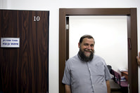 Benzion Gopshtein, leader of the far-right Israeli group Lehava, stands inside his lawyer's office before a news conference in Jerusalem, in this August 11, 2015 (Reuters Photo)