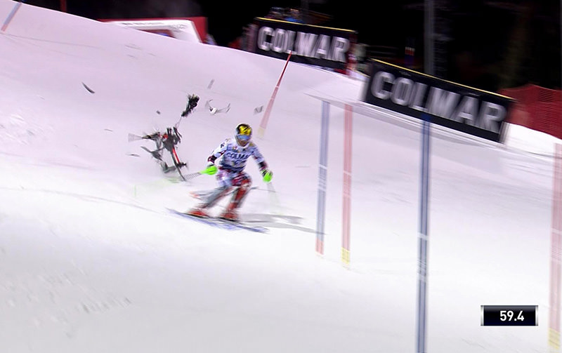 In this image taken from video a camera drone crashes into the snow narrowly missing Austria's Marcel Hirscher during an alpine ski (Infront Sport via AP)