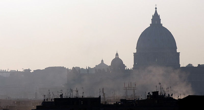 Smoke billows from chimneys in central Rome, in front of St. Peters's Basilica dome, Wednesday, Dec. 23, 2015 (AP Photo)