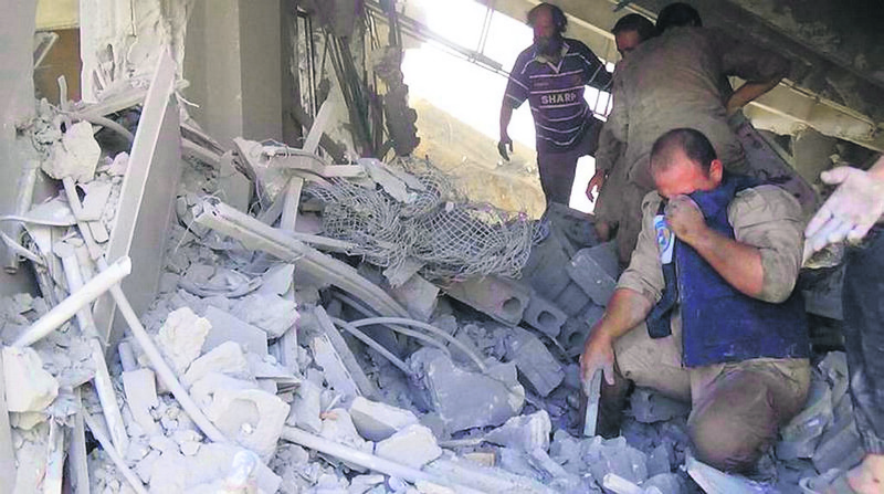 The aftermath of a Russian airstrike in Talbiseh, Syria that killed only civilians, according to activists.