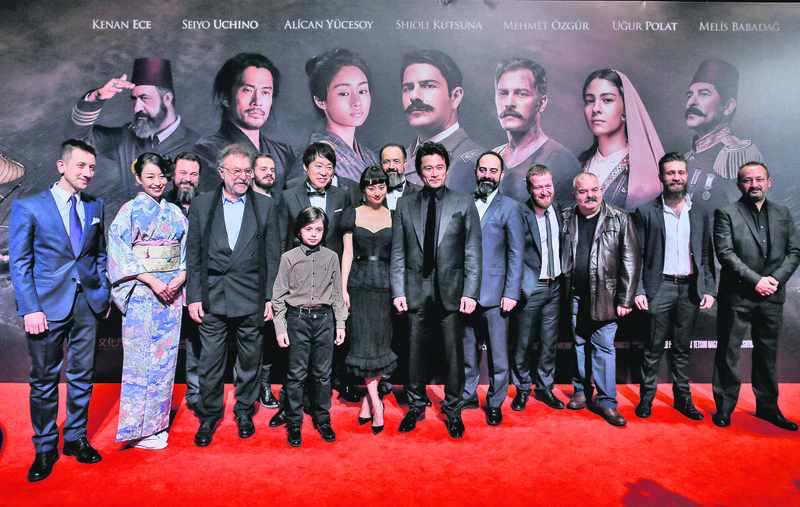 The cast and production team of ,Ertuu011frul 1890, (L) posed for the cameras before the screening. (AA Photo)