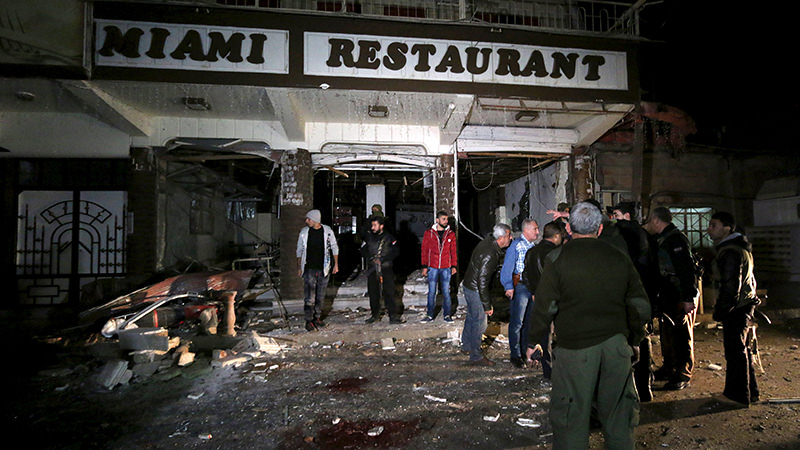 Residents inspect damage from a suicide bomb in Qamishli, Syria December 30, 2015. (Reuters Photo)