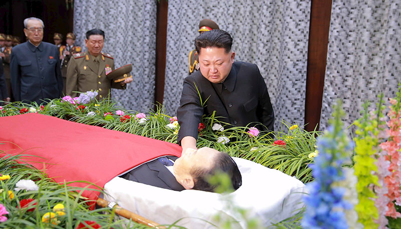 North Korean leader Kim Jong Un reacts as he pays his last respects to Kim Yang Gon in this undated photo released by North Korea's Korean Central News Agency (Reuters Photo)