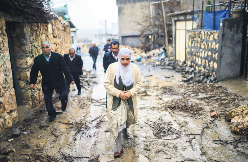 People return to their homes after the clashes between the security forces and PKK militants in the Dargeu00e7it district of Mardin province in southeastern Turkey.
