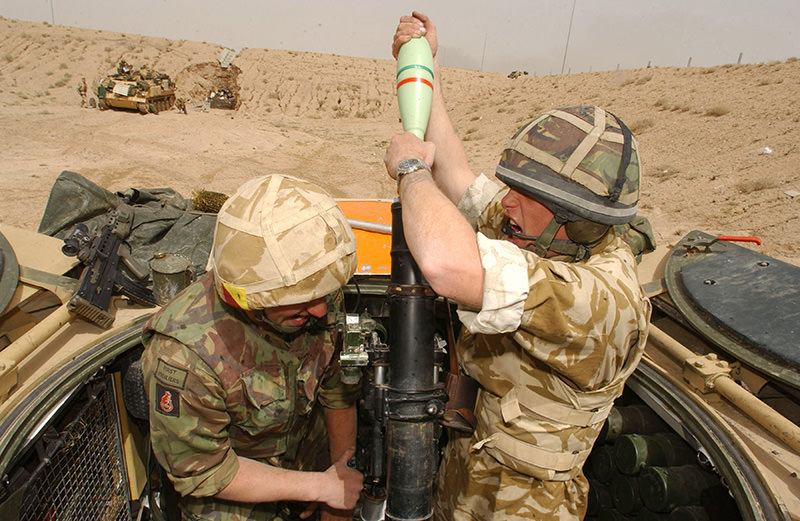 British soldiers engage Iraqi Army positions with their 81mm mortars south of Basra, 26 March 2003 (WikiMedia Photo)