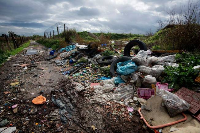 In this Nov. 18, 2013 photo, rubbish is piled up on the edge of cultivated land near Caivano, in the surroundings of Naples, southern Italy. (AP Photo)