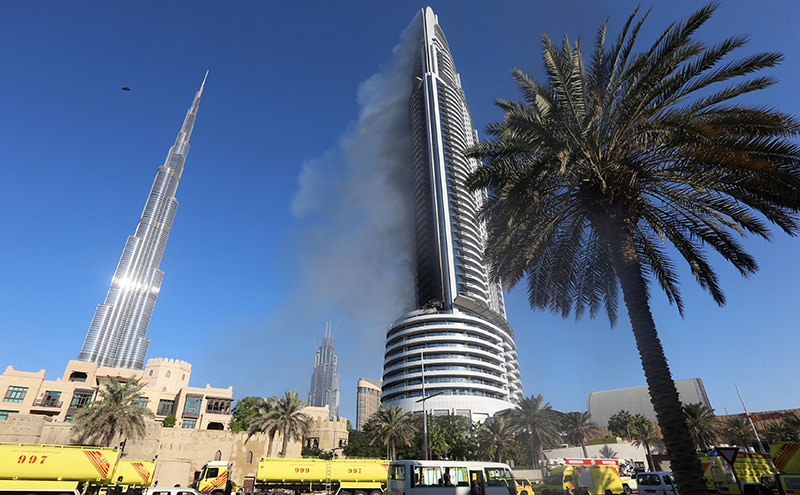 Plumes of smoke rise from the 63-storey Address Downtown Dubai hotel and residential block near the Burj Khalifa, the tallest building in the world, a day after the hotel caught fire  Reuters Photo