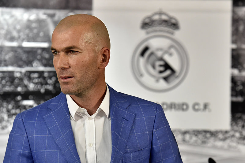 Real Madrid's new French coach Zinedine Zidane poses after a statement of Real Madrid's president at the Santiago Bernabeu stadium in Madrid on January 4, 2016. (AFP Photo)