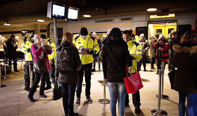 Security staff check IDs at Kastrups train station outside Copenhagen, Denmark, 04 January 2015. (EPA Photo)