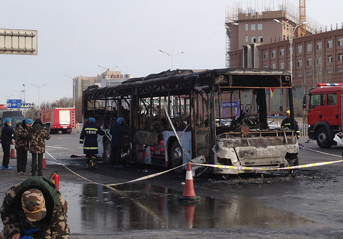 Firefighters work at an accident site of a bus fire in Yinchuan, the capital of Ningxia region, Tuesday, Jan. 5, 2016 (AP Photo)