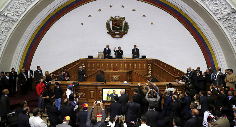 Henry Ramos Allup (C), the president of the National Assembly, preside a session at the National Assembly  with first Vice President Marquez (L)