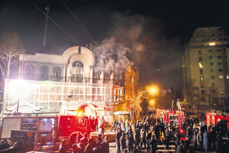 Iranian protestors set fire to the Saudi Arabian embassy building in Tehran, Iran  (EPA Photo)