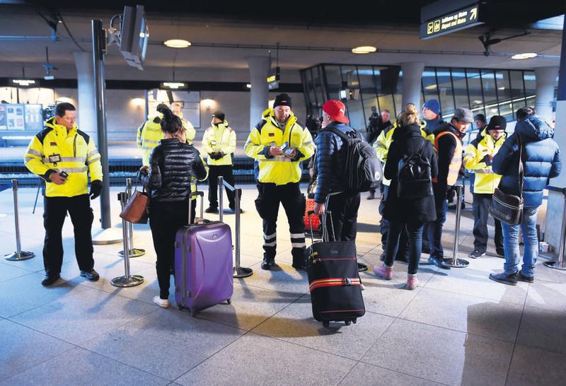 Security staff check IDs at Kastrups train station outside Copenhagen, Denmark. (EPA Photo)