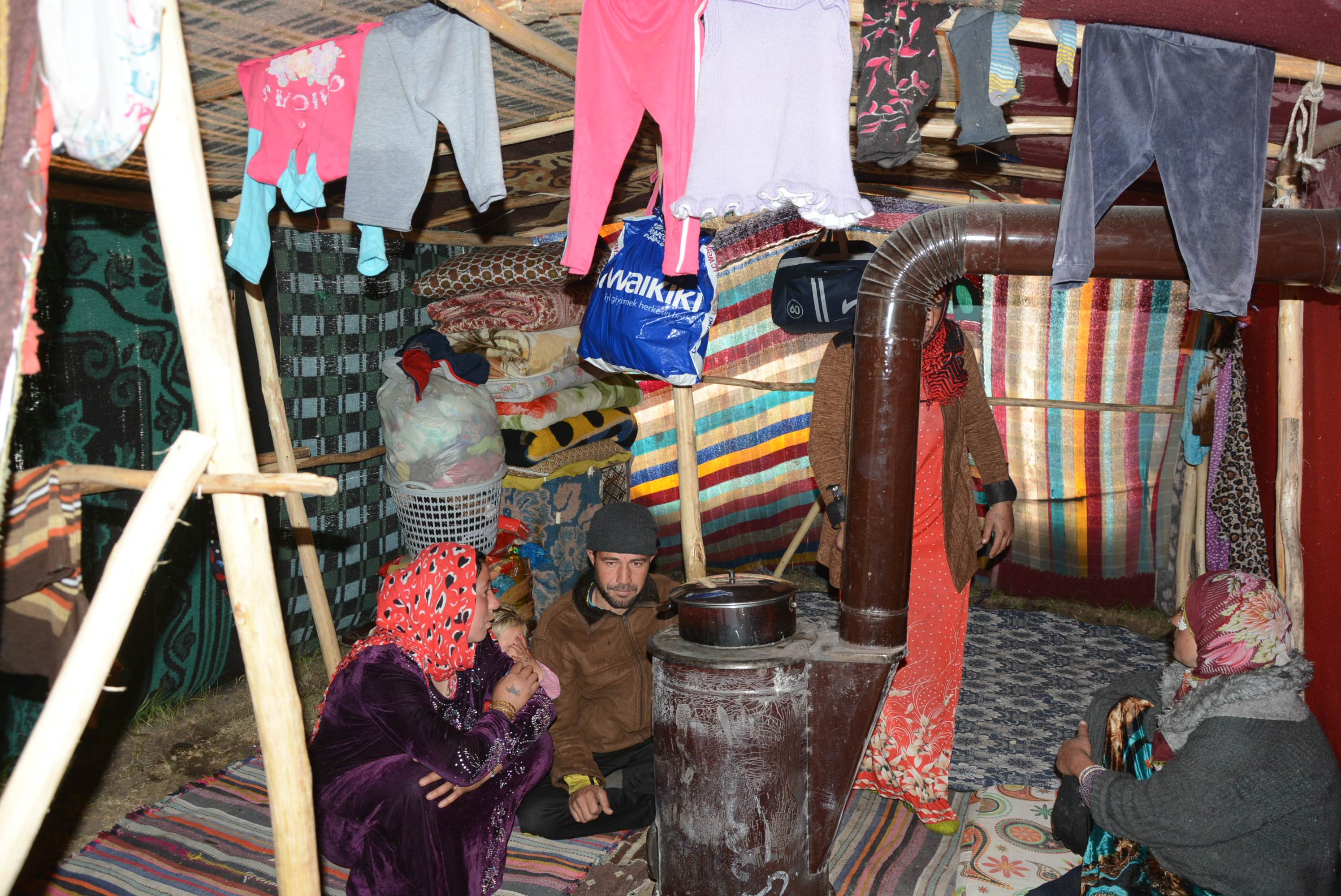 The family's tent was made out of blankets and they use a wood or coal burning stove to heat their shelter (AA Photo)