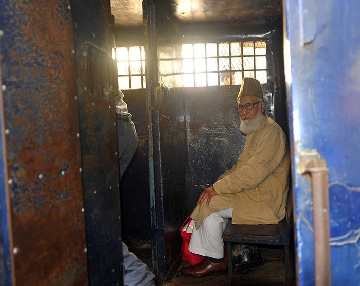 Motiur Rahman Nizami, a leader of Bangladesh Jamaat-E-Islami sits inside a prison vehicle (Reuters Photo)