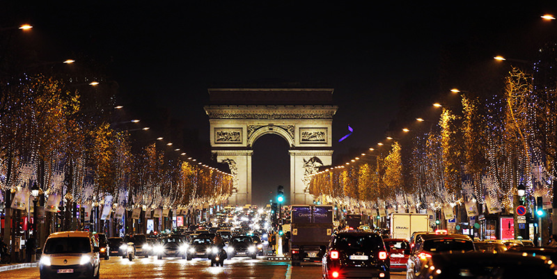 Christmas decorations illuminate the Champs Elysees, as the Arc de Triomphe is seen in the background, in Paris, Monday, Dec. 14, 2015. (AP Photo)