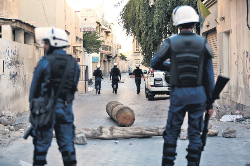 Riot police patrol on the lookout for protesters against Saudi Arabia's execution of Shiite cleric Sheikh Nimr al-Nimr in Daih, Bahrain.