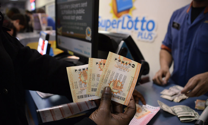 A customer shows their tickets for the Powerball lottery at the CA lotto store in San Bernardino County, California  (Reuters Photo)