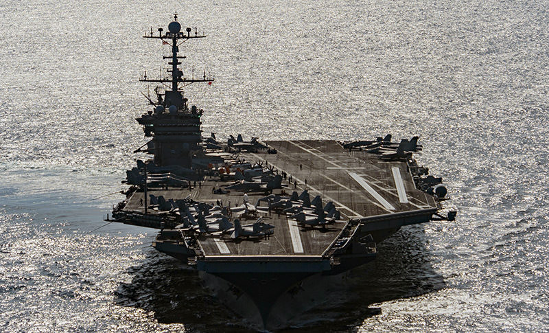 In this Friday, Dec. 25, 2015 photo released by the U.S. Navy, the aircraft carrier USS Harry S. Truman navigates the Gulf of Oman.  (AP Photo)