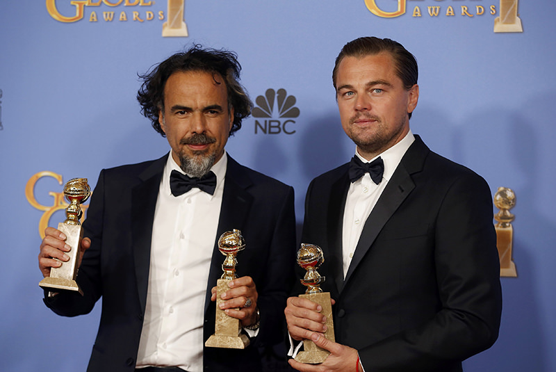 Director Alejandro Gonzalez Inarritu poses with the awards for Best Director and Best Motion Picture - Drama for ,The Revenant, (L) and actor Leonardo DiCaprio poses with the award for Best Performance by an Actor (Reuters Photo)