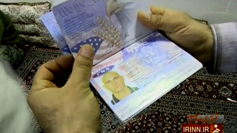 A handout image grab taken from a video released on January 13, 2016, by the Islamic Republic of Iran's News Network (IRINN), shows the passport of a US Navy sailor in the Farsi Island (AFP Photo)