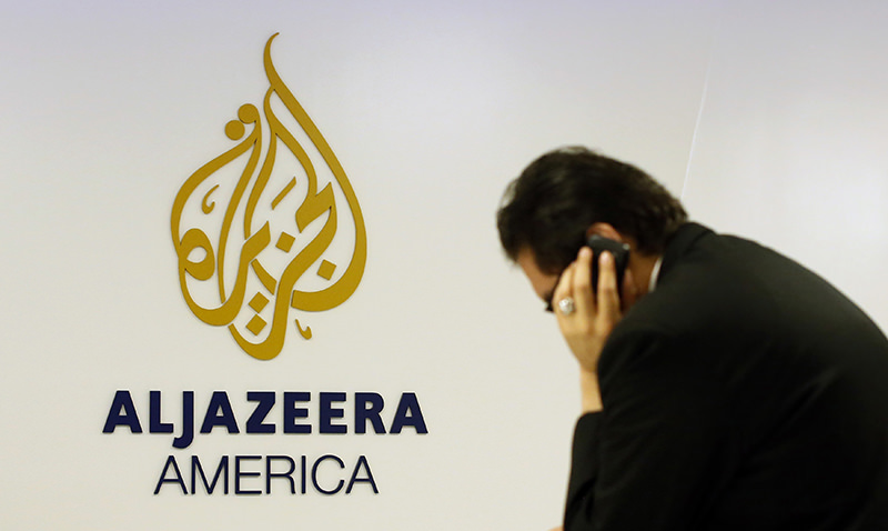 A man works at a desk in the Al Jazeera America broadcast center in New York, in an August 20, 2013 file photo. (Reuters Photo)