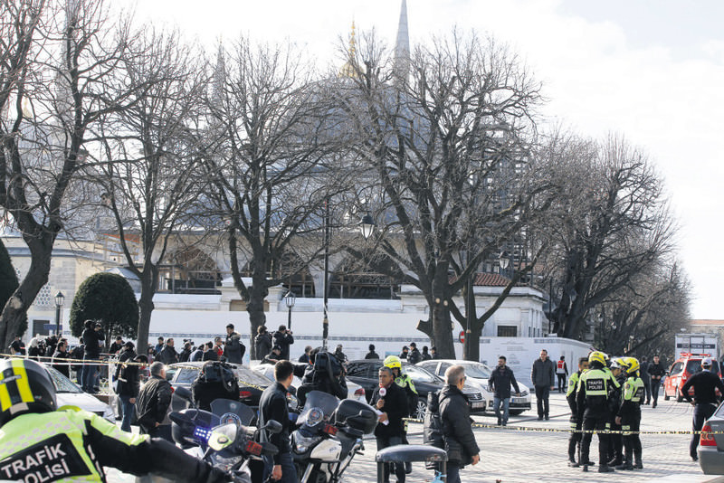 Police and media gather in front of the Blue Mosque at the historic Sultanahmet district in Istanbul after an explosion killed 10 people and wounded 15 others.